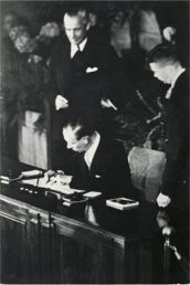 Denmark's Secretary of State, Gustav Rasmussen, signs the NATO treaty