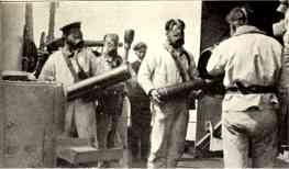 Pre-war picture of the gun crew at the NIELS IUEL's 15 cm guns, wearing gas masks
